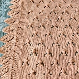 Hand Knitted Peach Baby Blanket.